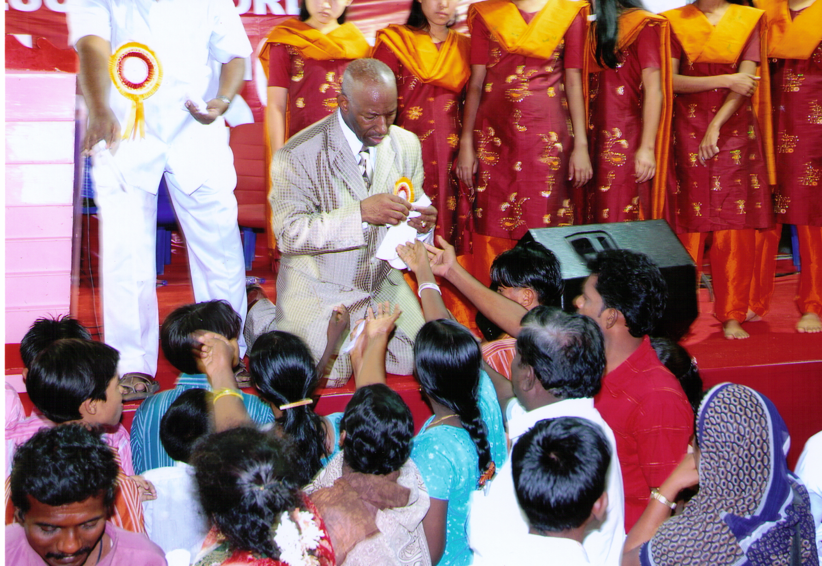 Apostle McFarlane Distributing Anointed Oil & Prayer Cloths at the Revival in India 2008