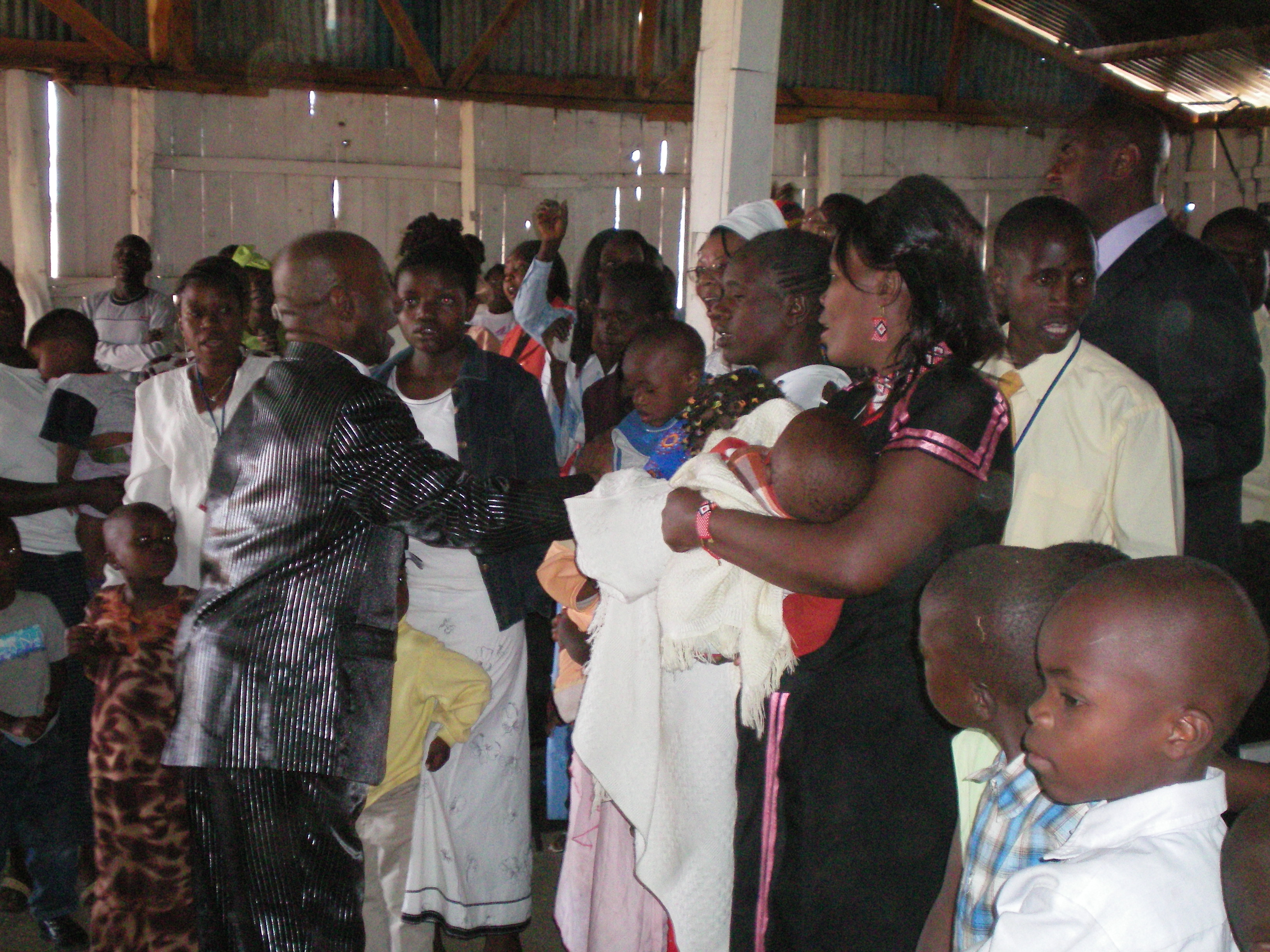 Apostle McFarlane Laying Hands on the Sick during the Mission to Kenya 2007