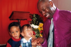 Apostle McFarlane with Two of the Youngest Members of BOTR Philippines